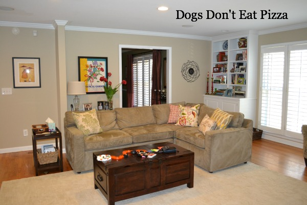 living room with rug under furniture - how to arrange furniture around an area rug - Mohawk Homescapes