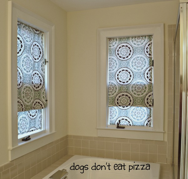 Add personality to your bath decor - Make fun faux Roman shades out of shower curtains for the bathroom - mohawkhomescapes.com