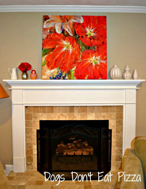 orange-in-painting-above-neutral-fireplace - Mohawk Homescapes