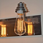 vintage bulb in bathroom fixture - Dogs Don't Eat Pizza