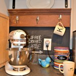 coffee station with reclaimed wood hooks - kitchen - Dogs Don't Eat Pizza