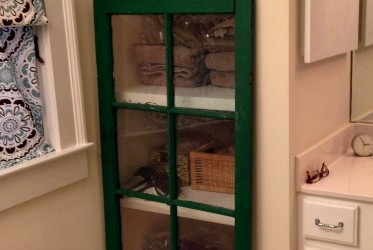 salvaged window as door to cabinet - Dogs Don't Eat Pizza