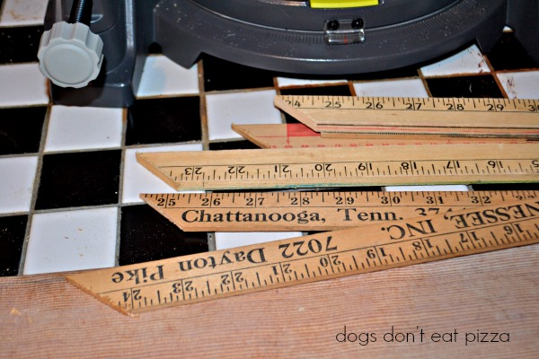 yard sticks 45 degree miter cut - Christmas countdown chalkboard - Dogs Don't Eat Pizza