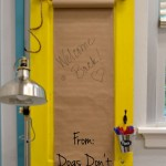 How to turn an old door into a memo board - it's an easy and fun repurposing project! dogsdonteatpizza.com