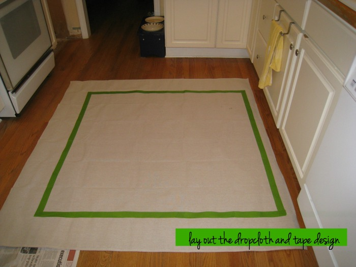 lay out dropcloth and tape off design - dropcloth curtain - Dogs Don't Eat Pizza