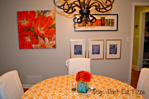 bright dining room with gallery wall
