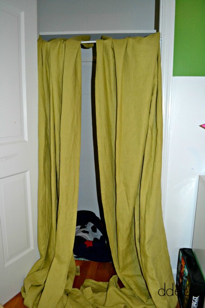 play fort made with curtains
