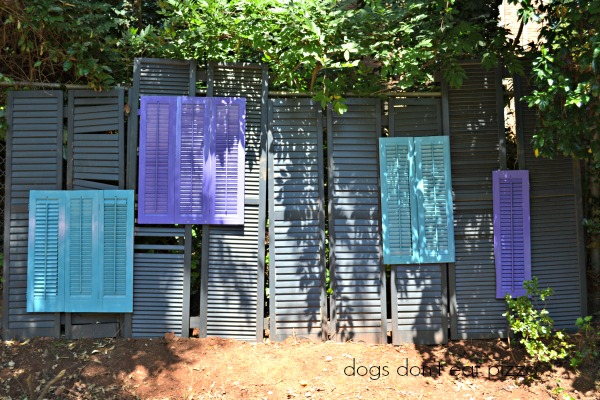 Finished shutters into a privacy screen - thediybungalow.com
