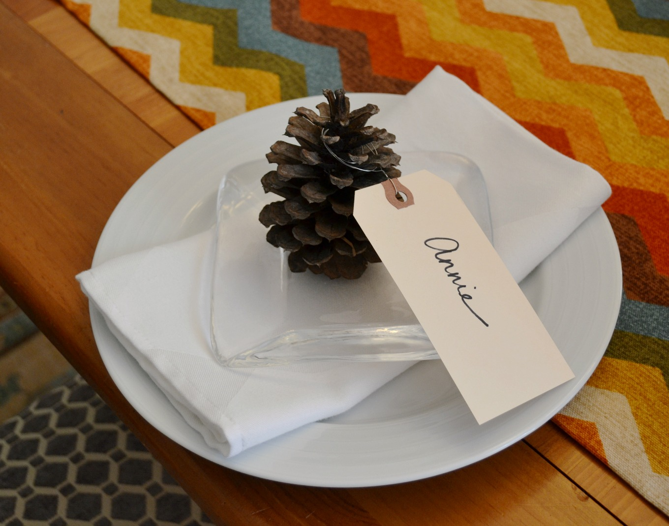 Pinecones make great place card holders to bring natural elements to Thanksgiving table - thediybungalow.com