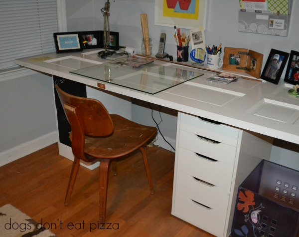 old door repurposed into a desk - Five Ways to Repurpose Old Doors - thediybungalow.com