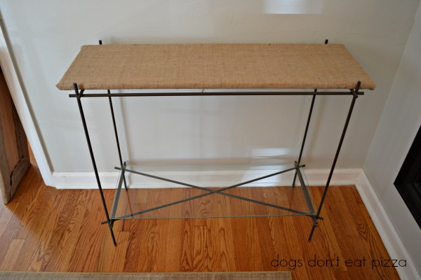 Giving weight to small furniture by adding a fabric-covered shelf - thediybungalow.com