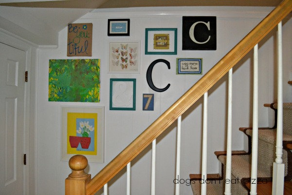 Create the gallery wall at the same angle as the stairs as one of five ways to decorate a big wall - thediybungalow.com