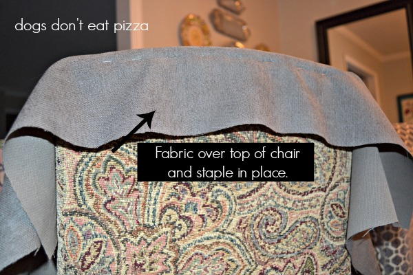 Staple the fabric to the top of the chair in a line - how to reupholster parsons chairs - thediybungalow.com