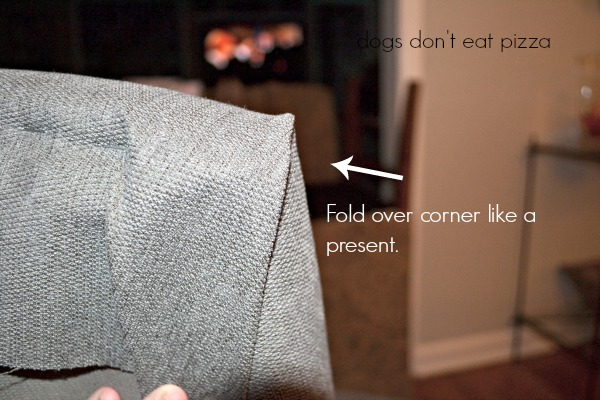Fold the corners to staple - how to reupholster parsons chairs - thediybungalow.com