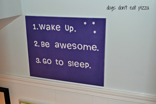 Spray paint canvas over letter stickers to make a fun sign - TheDIYBungalow.com