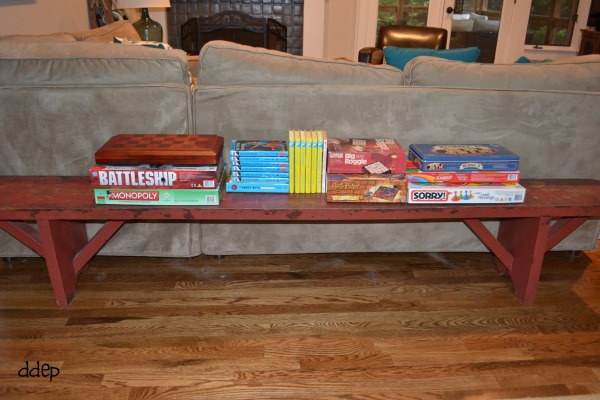 Red bench with games and books in the family room - thediybungalow.com