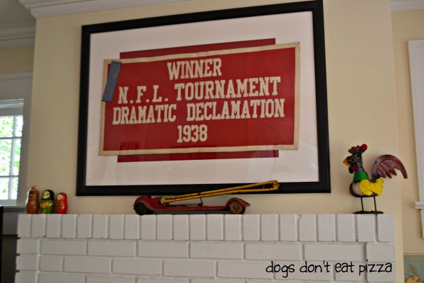 My grandmother's speech vintage banner in the living room of the 1929 House - thediybungalow.com