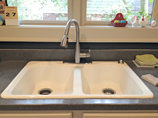 cast iron sink from Habitat for Humanity ReStore - kitchen - thediybungalow.com