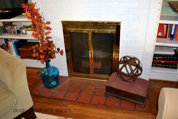 Fireplace in the living room of the 1929 House - thediybungalow.com