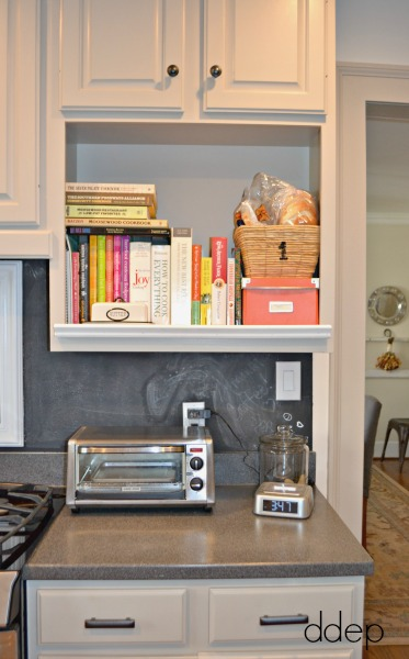 microwave shelf into cookbook storage - kitchen - thediybungalow.com