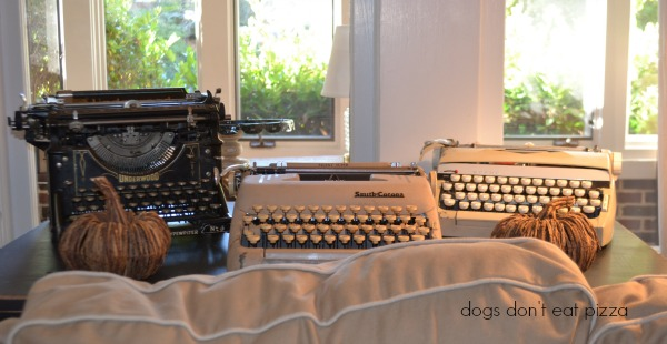 Typewriter collection in the living room in the 1929 House - thediybungalow.com