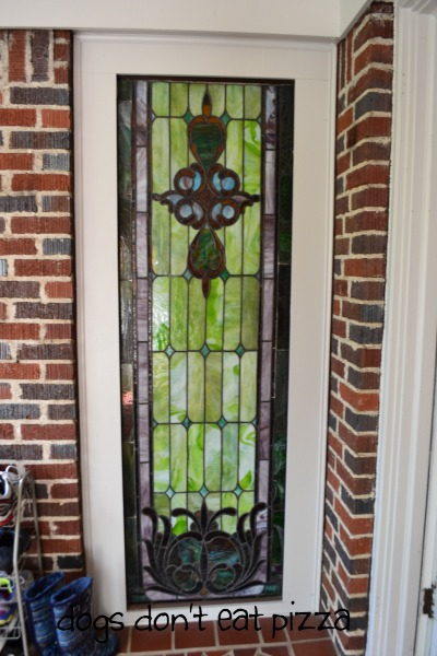 Stained glass window on front porch outside living room in 1929 House - thediybungalow.com
