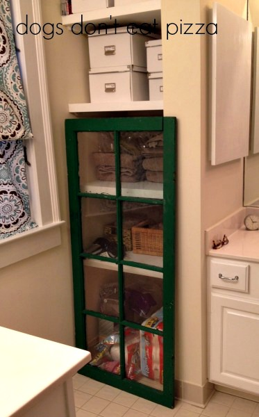 salvaged window as door to cabinet - thediybungalow.com