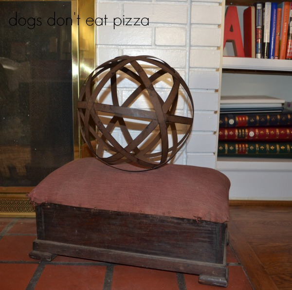 Vintage footstool and bronze orb in the living room in the 1929 House - thediybungalow.com
