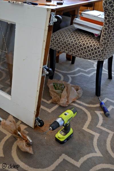 Add casters to bottom of door - How to Turn a Door into a Sliding Door - thediybungalow.com