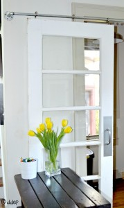How to turn an old door into a sliding door - thediybungalow.com