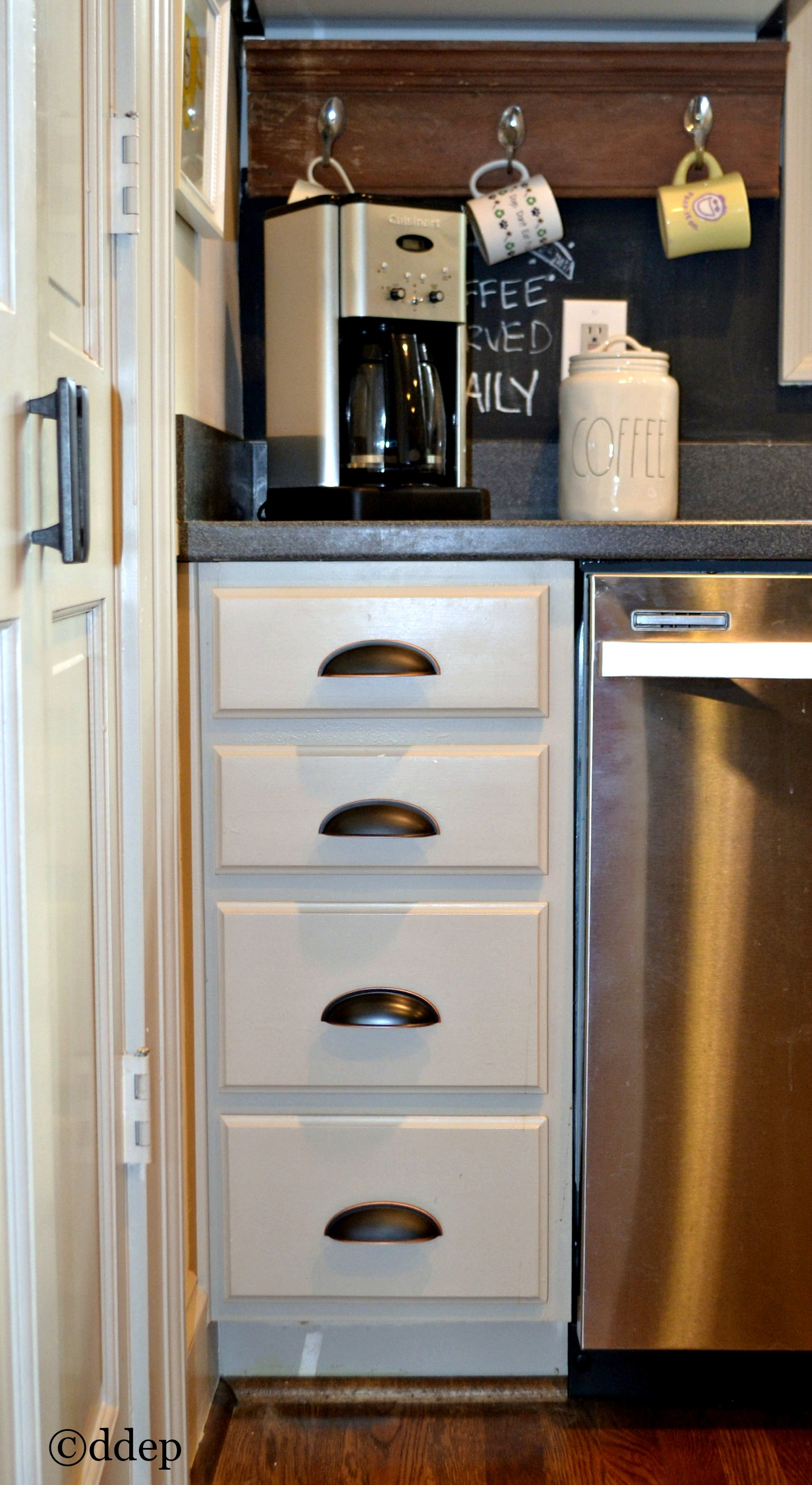 Silverware drawers near the dishwasher make for an organized and efficient kitchen - thediybungalow.com
