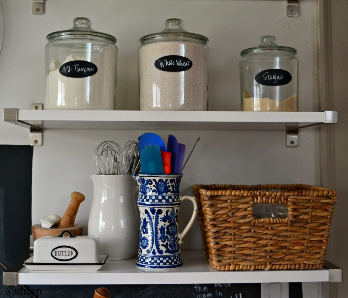 three storage jars on shelves - open shelving in the kitchen - thediybungalow.com