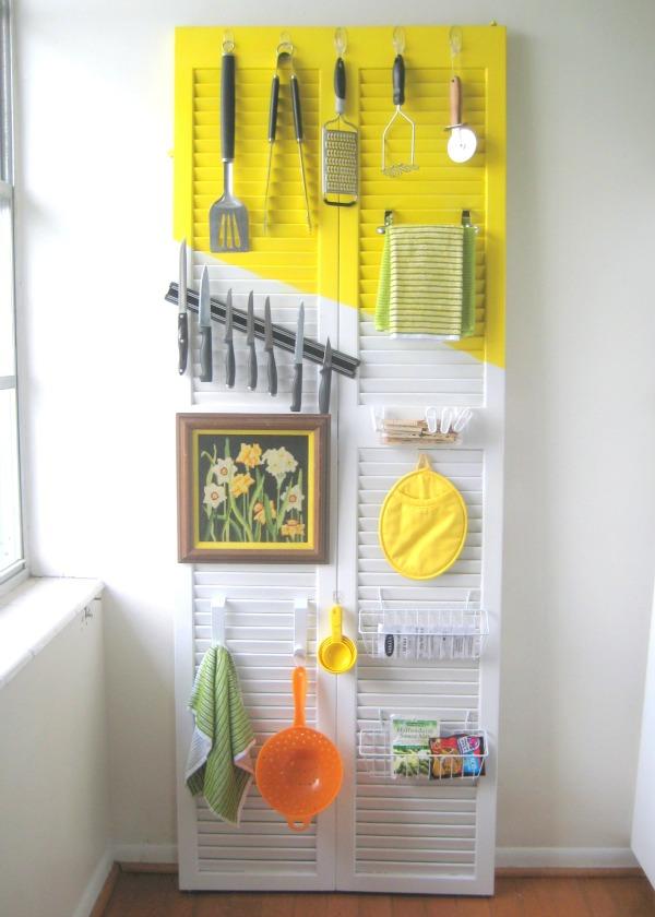 CRAFT door into kitchen storage - Five Ways to Repurpose Old Doors - thediybungalow.com