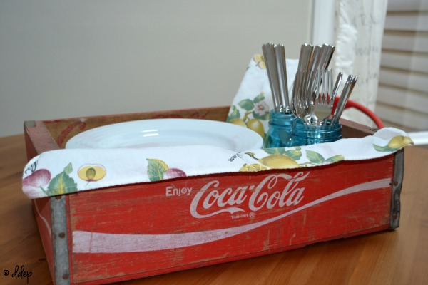 Coke crate as buffet server - Five Ways to Use a Vintage Coke Crate - thediybungalow.com