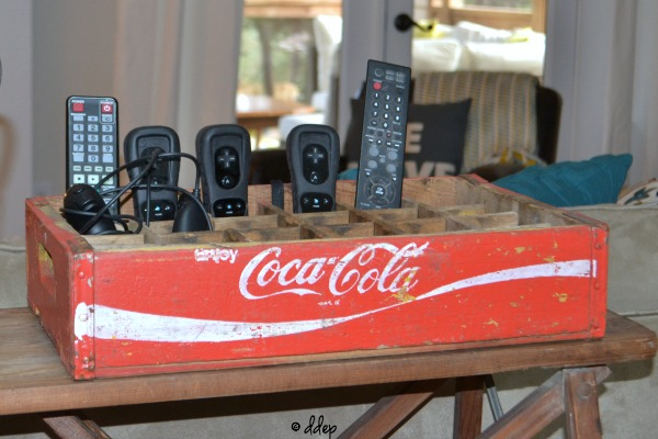 Keep remote controls under control - Five Ways to Use a Vintage Coke Crate - thediybungalow.com