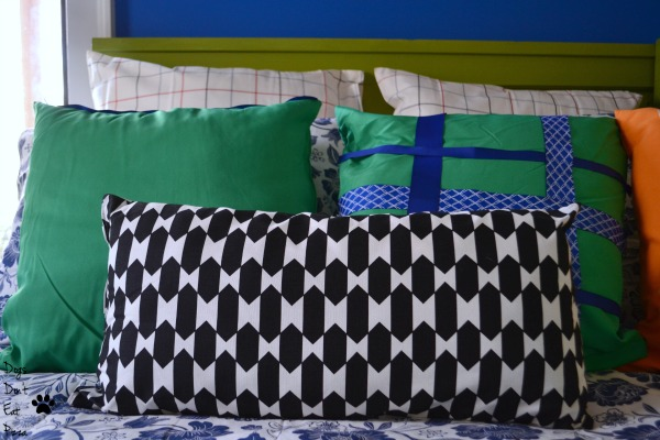 Pile the pillows on the bed to make guests extra comfy - thediybungalow.com