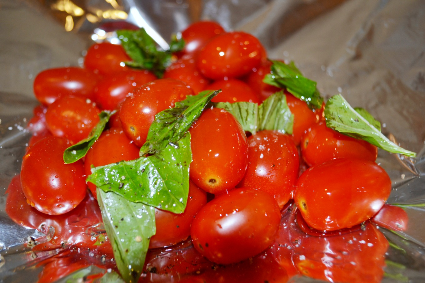 Foil packets with tomatoes, basil, and olive oil are one of my easy recipes for the grill - thediybungalow.com