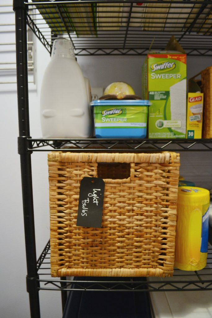 Cleaning products and more stored in the laundry room reveal - thediybungalow.com