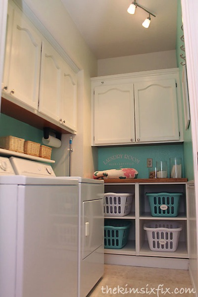 Laundry room makeover from The Kim Six Fix with laundry sorters - thediybungalow.com