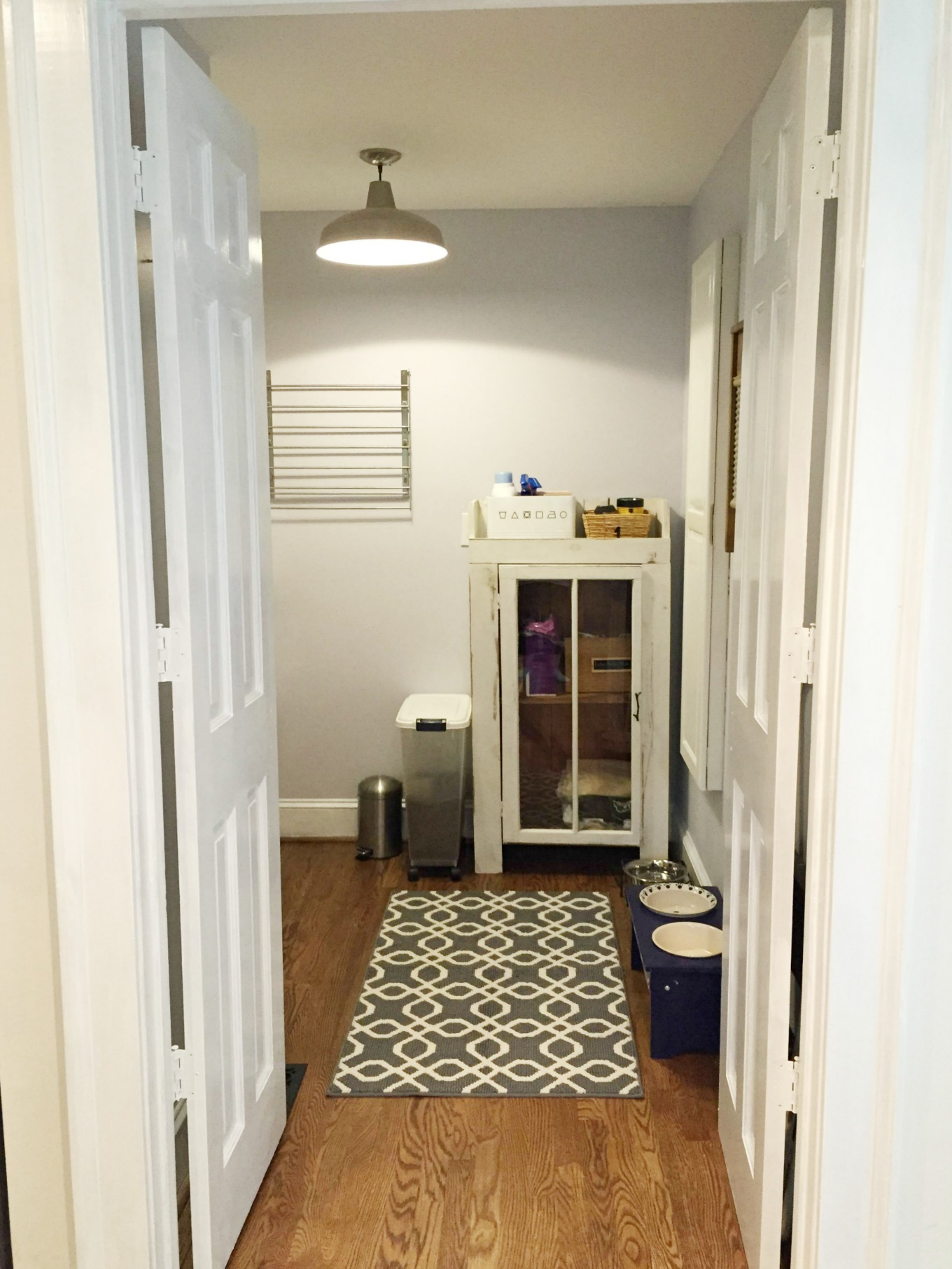 Storage cabinet in laundry room reveal - thediybungalow.com
