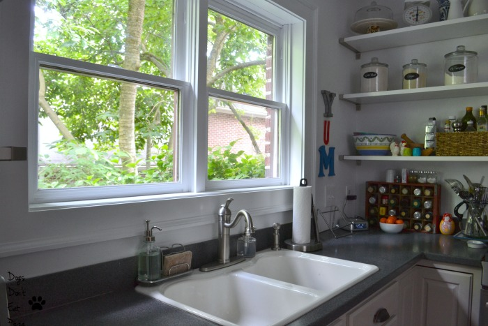 White painted trim on window brightens kitchen - painted kitchen - Dogs Don't Eat Pizza