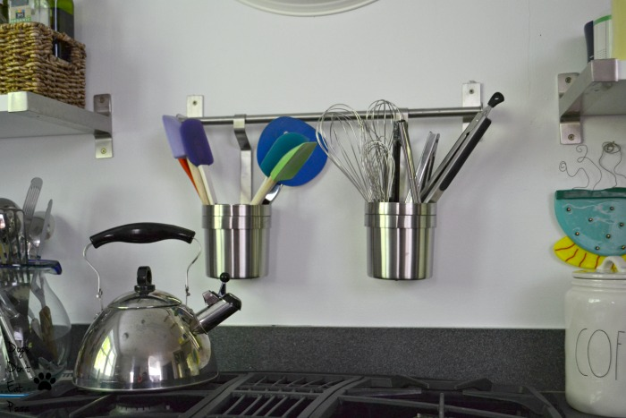 Cooking utensils hanging over stove for an organized and efficient kitchen - thediybungalow.com