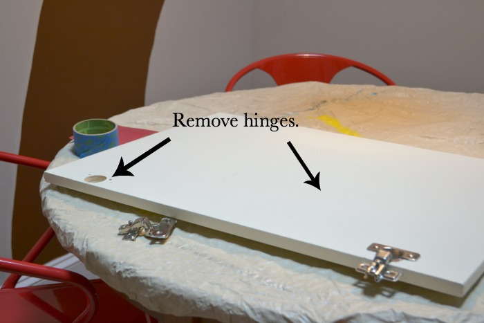 Remove hinges from cabinet doors - How to turn a cabinet door into a memo board - thediybungalow.com