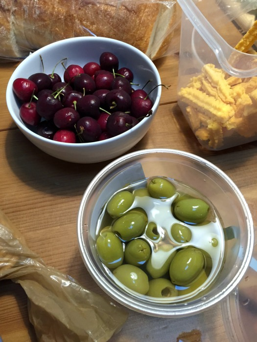 Olives and cherries and cheese straws and crusty bread are part of a perfect breadboard dinner - thediybungalow.com