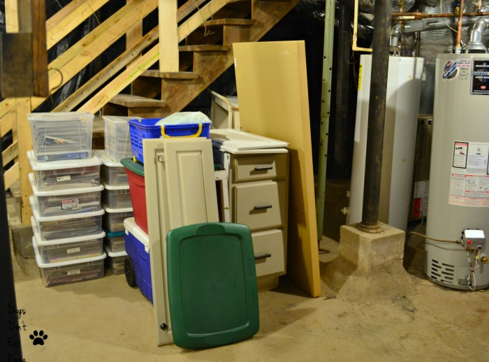 Put heavier items near the stairs so they are easier to move in how to organize an unfinished basement - thediybungalow.com