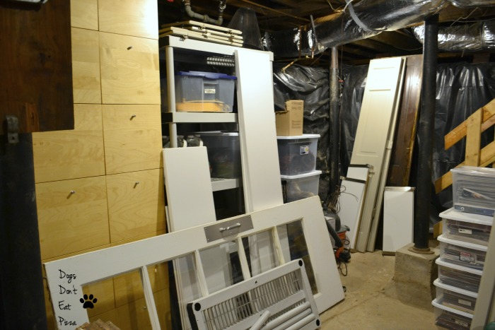 Doors and shelves storage for how to organize an unfinished basement - thediybungalow.com