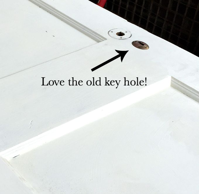 Look for an old door with cool details like this key hole - how to turn an old door into a memo board - thediybungalow.com