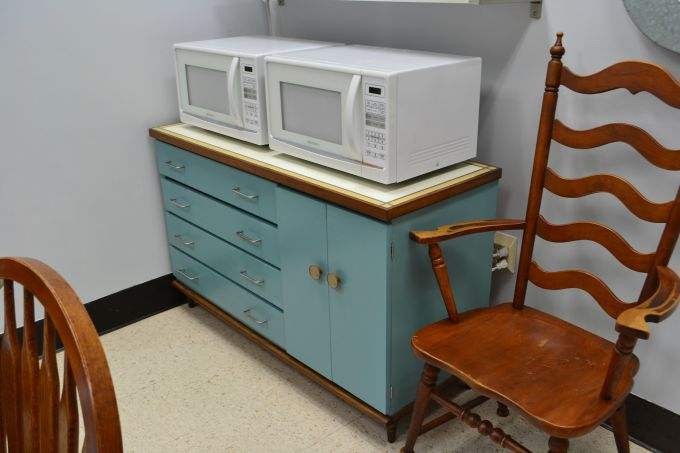 Vintage mid-century modern buffet with two microwaves added to the teachers' lounge renovation - thediybungalow.com