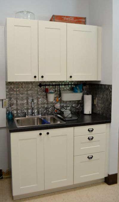 Cabinets that are new and match and provide great storage in the teachers' lounge renovation - thediybungalow.com