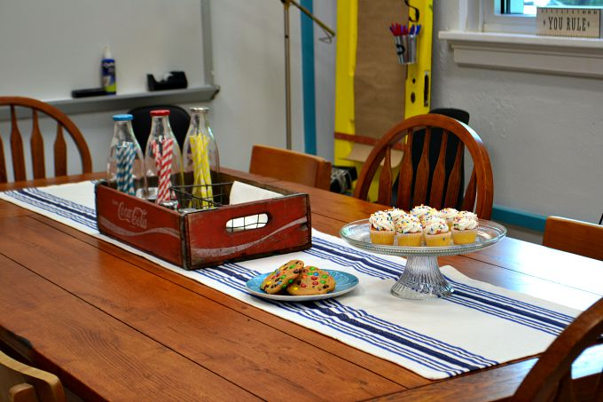 This beautiful table was hiding under oil cloth before in the teachers' lounge renovation - thediybungalow.com